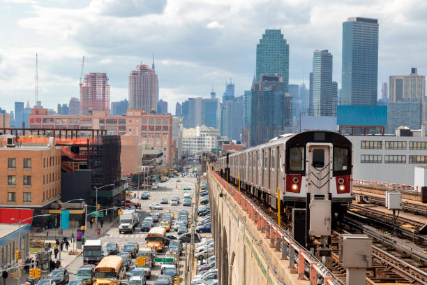 Subway Train Approaching  Elevated Subway Station in Queens, New York stock photo