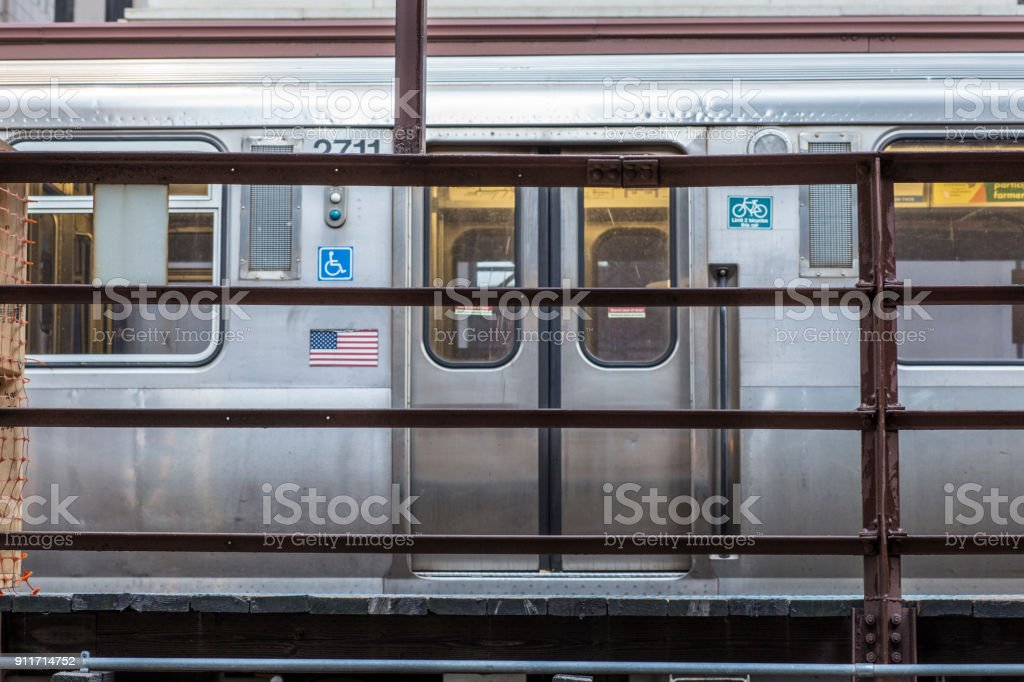 Subway train at rest on elevated platform stock photo