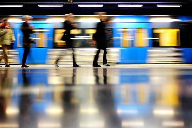 subway train in profile, and commuters - waiting for a train sweden bildbanksfoton och bilder