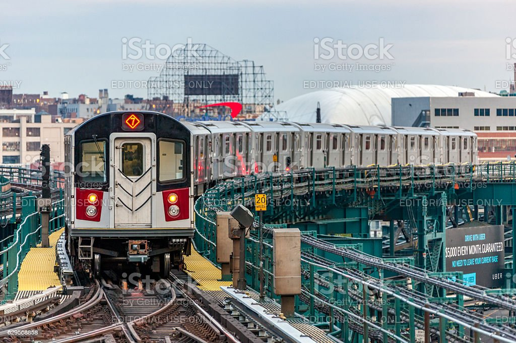 MTA subway train on elevated track in Queens, NYC stock photo