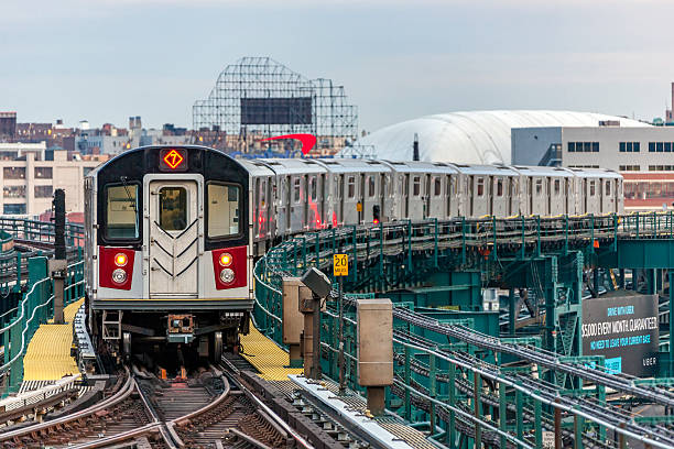 mta subway train on elevated track in queens, nyc - railway signal stock photos and pictures