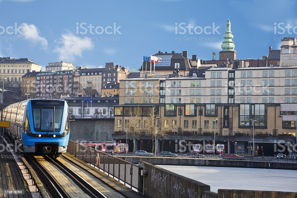 Subway train passing a bridge over water in Stockholm, Sweden stock photo