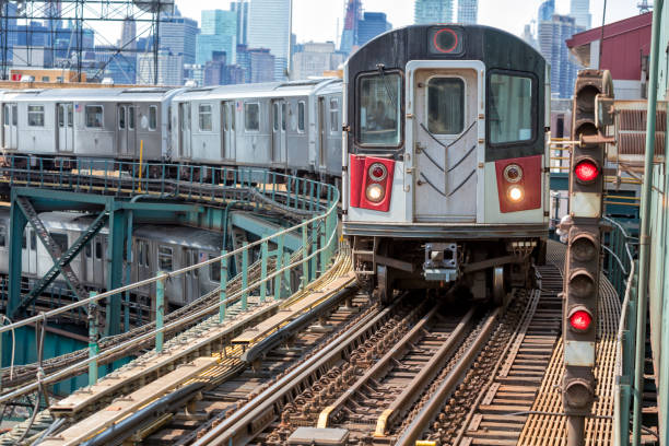 Subway Trains Speeding on Elevated Track in Queens, New York stock photo