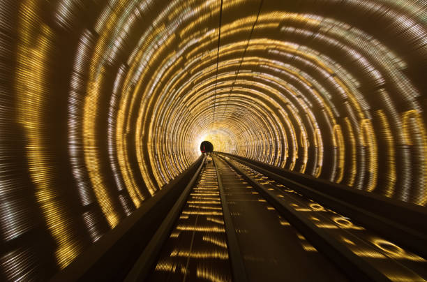 Subway tunnel lit up with rope lights stock photo