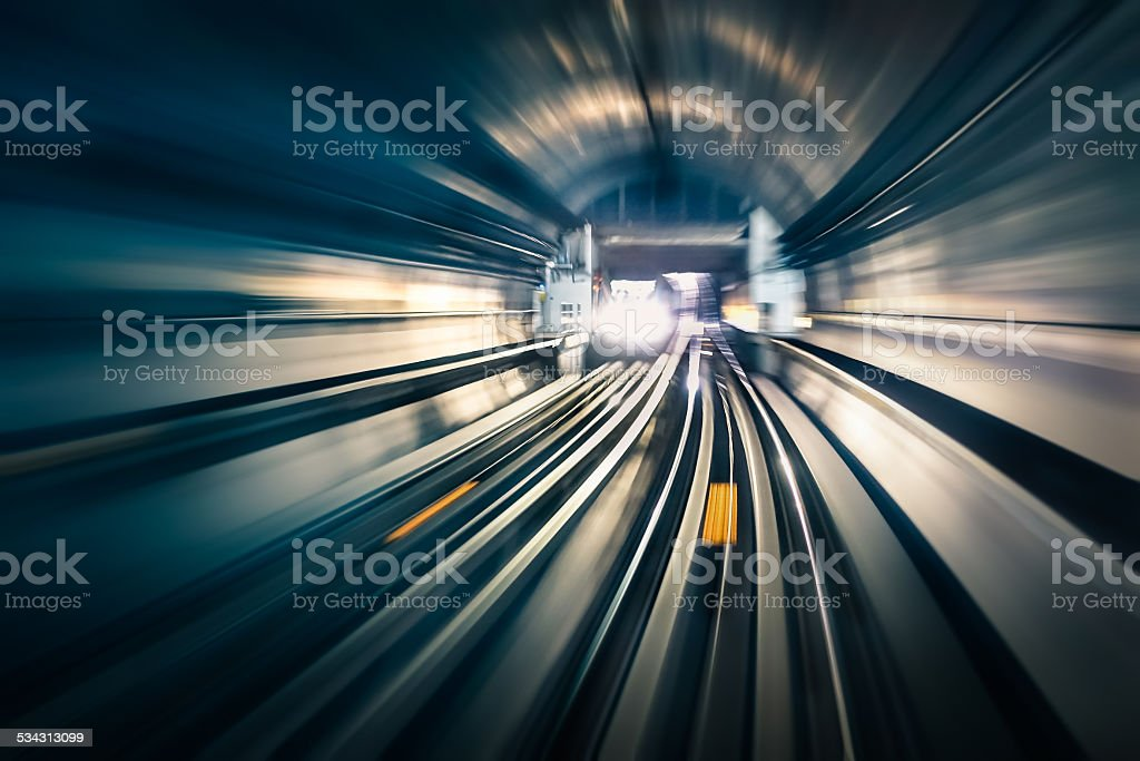 Subway tunnel with blurred light tracks with arriving train stock photo