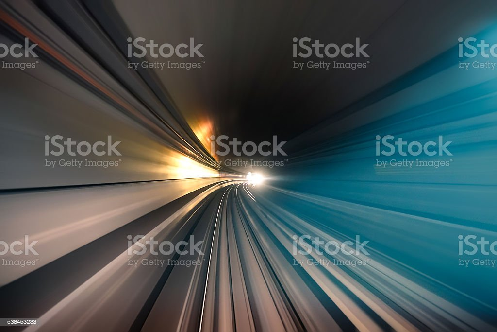 Subway tunnel with speed blurred light tracks in gallery stock photo