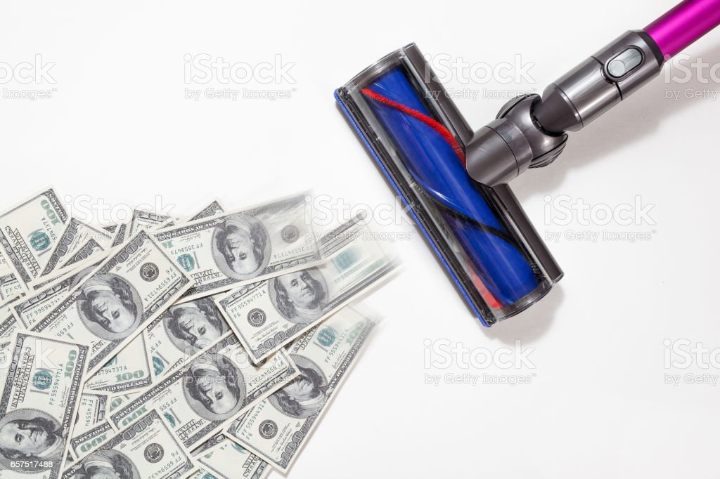 succeed in business concepts,vacuum cleaner draw dollars on white backgrounds, isolated stock photo