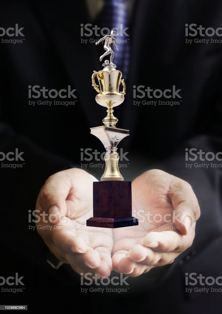 Succes in sport business concept, Businessman carry vintage sport...