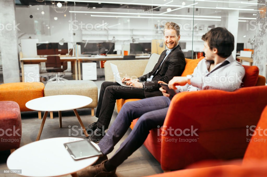 Succesful businesspeople working on devices stock photo