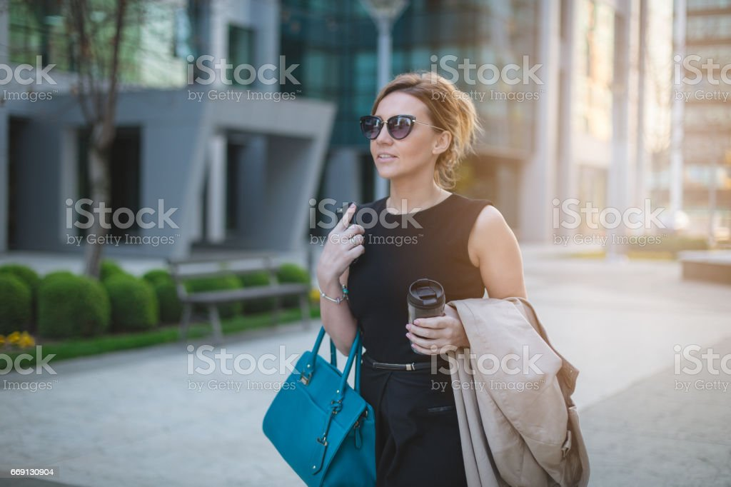 Succesful entrupenur walking in busniess distric stock photo