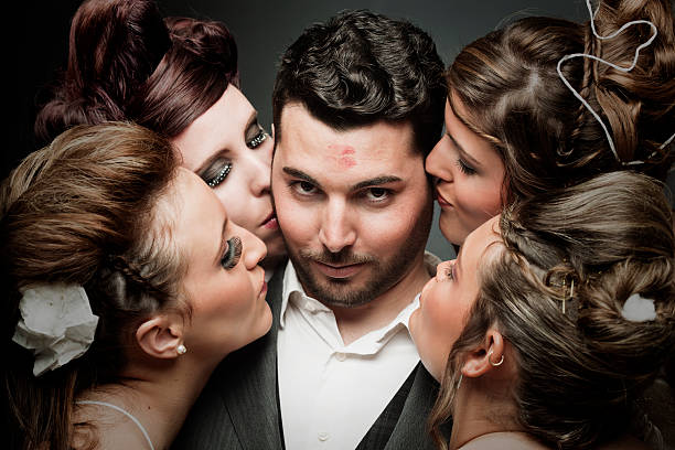 Succesful latin lover, a groom with four brides. One handsome groom with four brides. More files of this models on port. Made with professional make-up and hair dresser. Horizontal format. adulation stock pictures, royalty-free photos & images