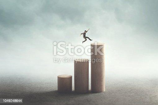 man big jump to reach the top
