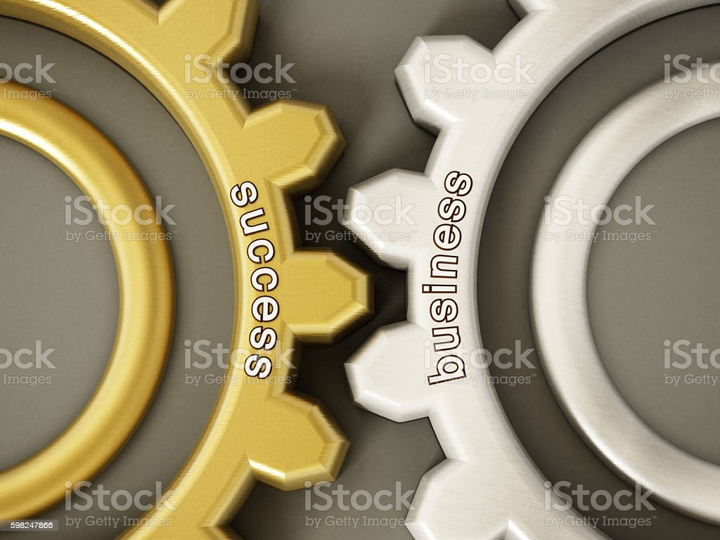 Success and business written wheels in motion stock photo