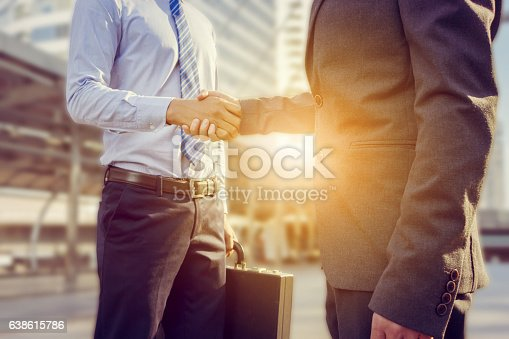 istock Success and Happiness concept, Businessman handshake at city outside office. 638615786