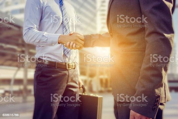 Success And Happiness Concept Businessman Handshake At City Outside Office Stock Photo - Download Image Now