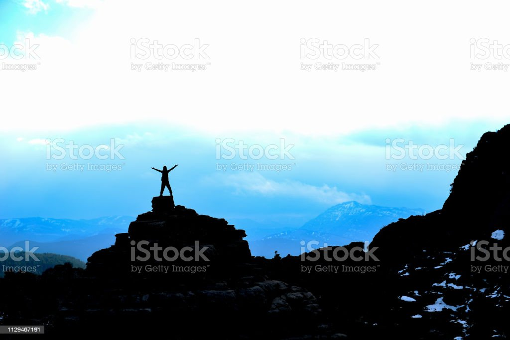 success and happiness in the summits of the mountains stock photo