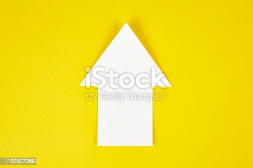 Success arrow icon on yellow background