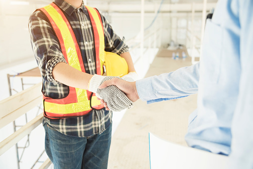 912867216 istock photo Success business concept. Worker peoples handshaking after complete deal. 961374250