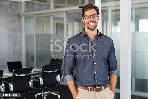 istock Success businessman smiling in office 1189303518