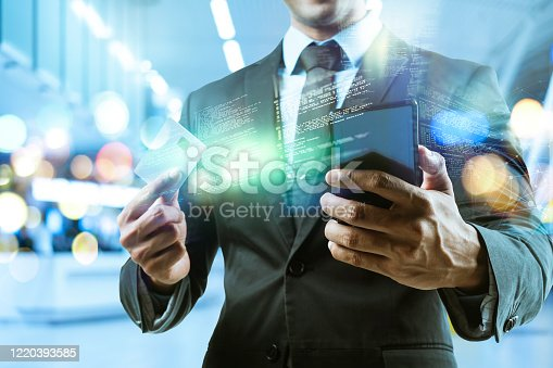 1127866562 istock photo Success businessman with hi-tech smart gadget technology iOT internet of things, business investment graph chart 3D futuristic virtual office blur background, finance business report data manage 1220393585