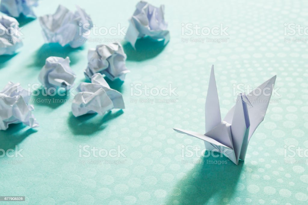 Success concept, A origami paper bird and crumpled paper balls royalty-free stock photo