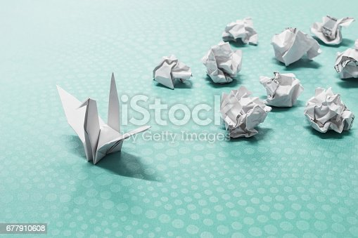 istock Success concept, A origami paper bird and crumpled paper balls 677910608