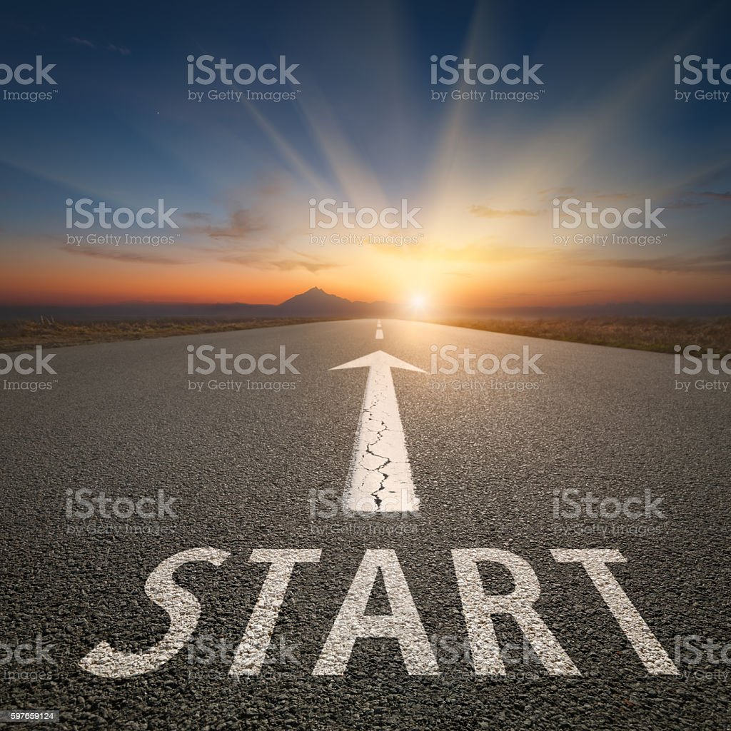 Success concept on open road with start text at sunset stock photo