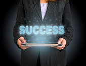 istock Success concept on tablet with hologram 1146755603
