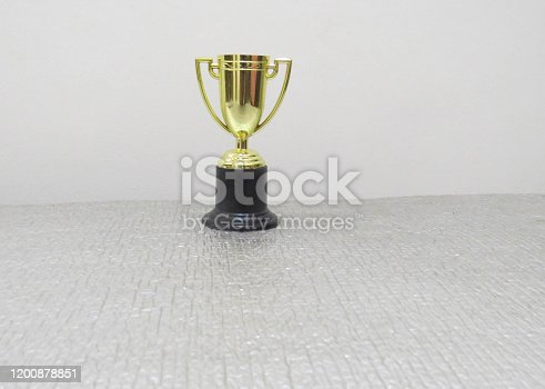 544347868 istock photo Success concept victory trophy. 1200878851
