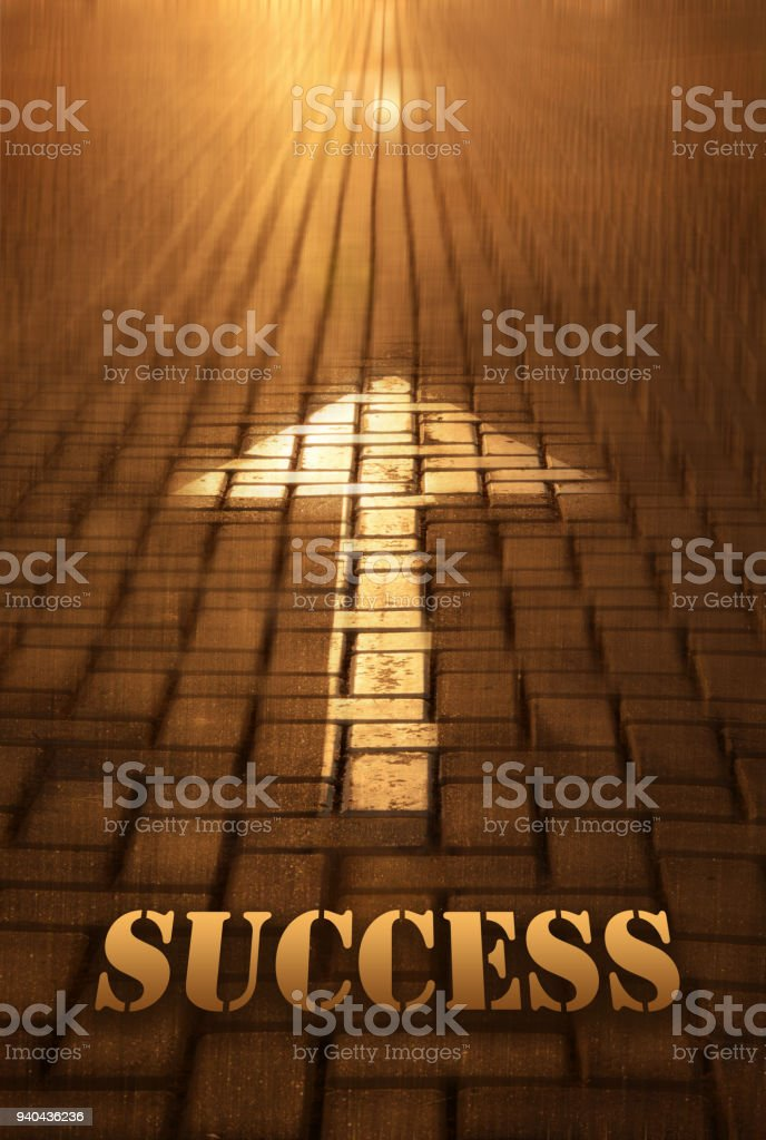 Success concept with arrow. Success word written on road at the sunset stock photo