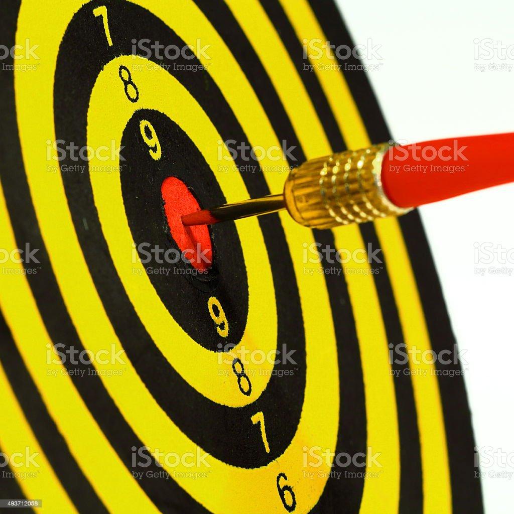 Success! Dart in Bull\'s-eye direct hit