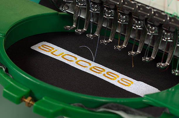 success embroidery - embroidery machine stock pictures, royalty-free photos & images
