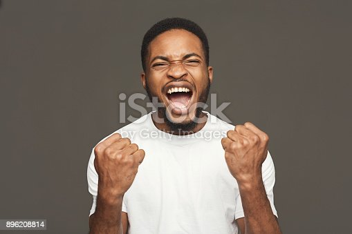istock Success, excited black man with happy facial expression 896208814