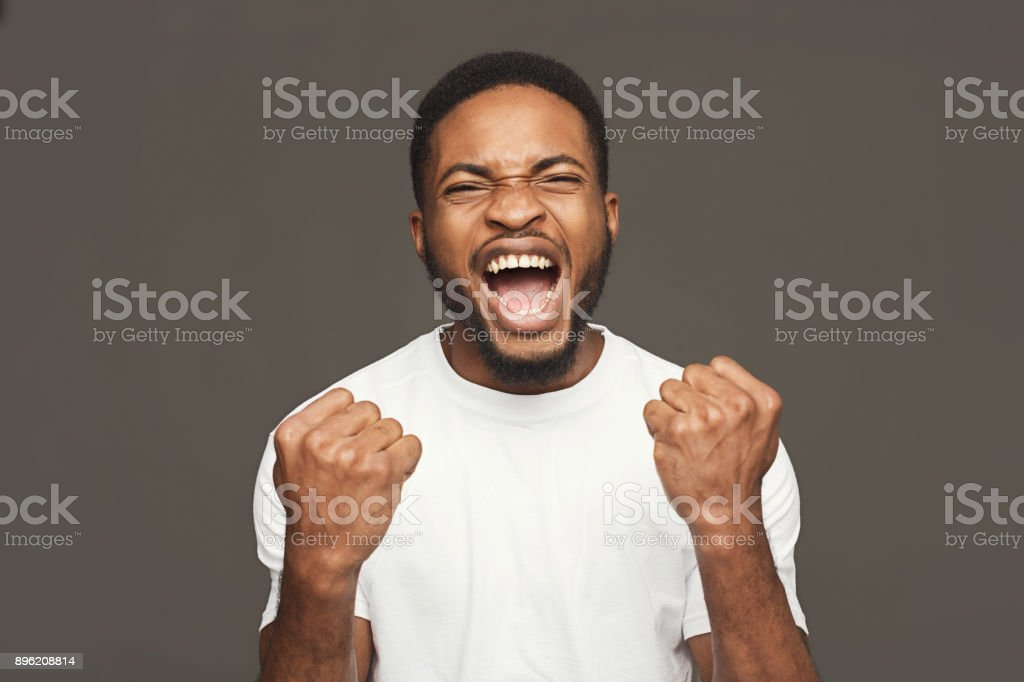Success, excited black man with happy facial expression stock photo