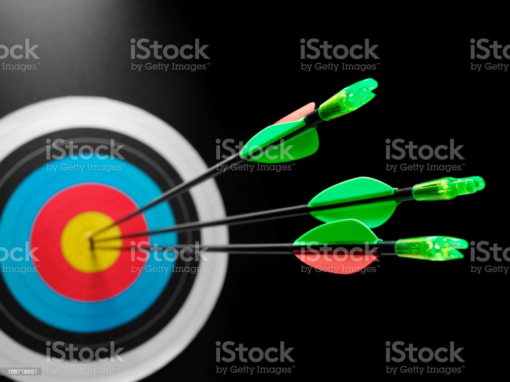 Success in Hitting a Archery target stock photo