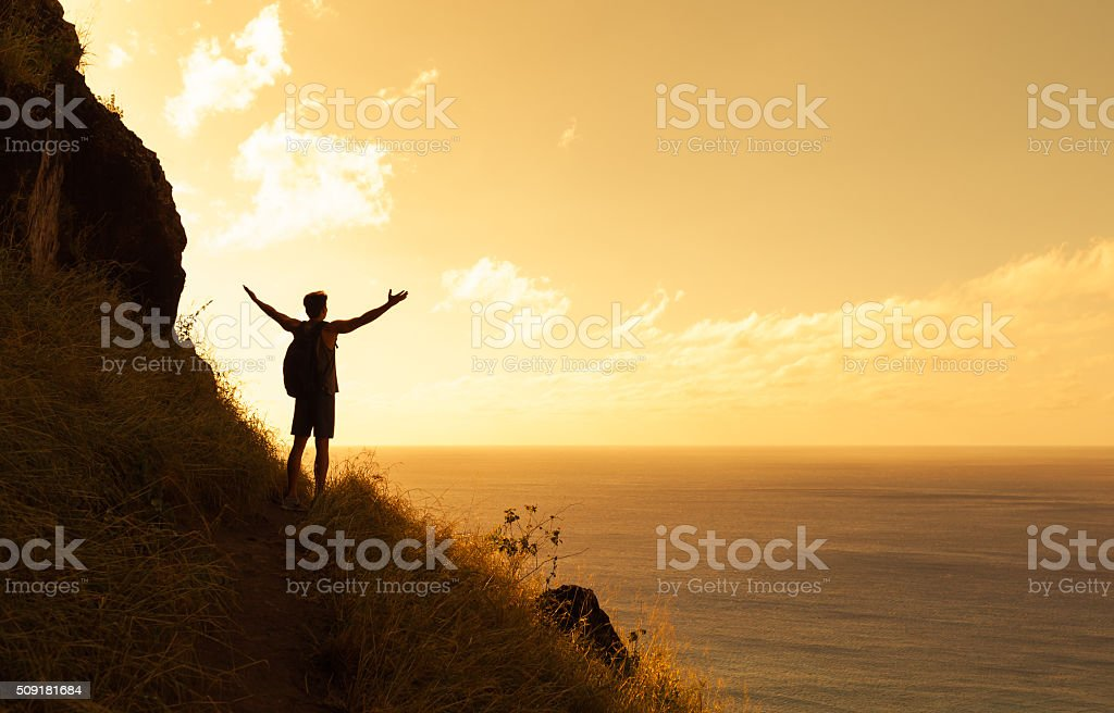 Success in majestic sunset stock photo