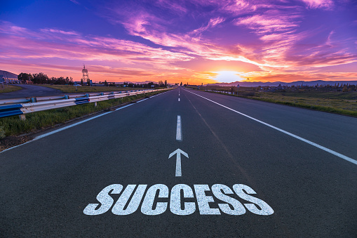 success in the asphalt road at the sunset