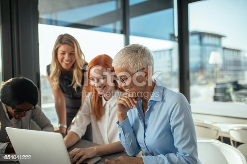 Business women enjoying working together in the office.