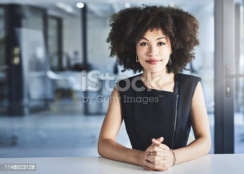 Portrait of a beautiful young businesswoman sitting at her office desk at work