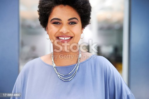 Portrait of an attractive young businesswoman posing inside her office