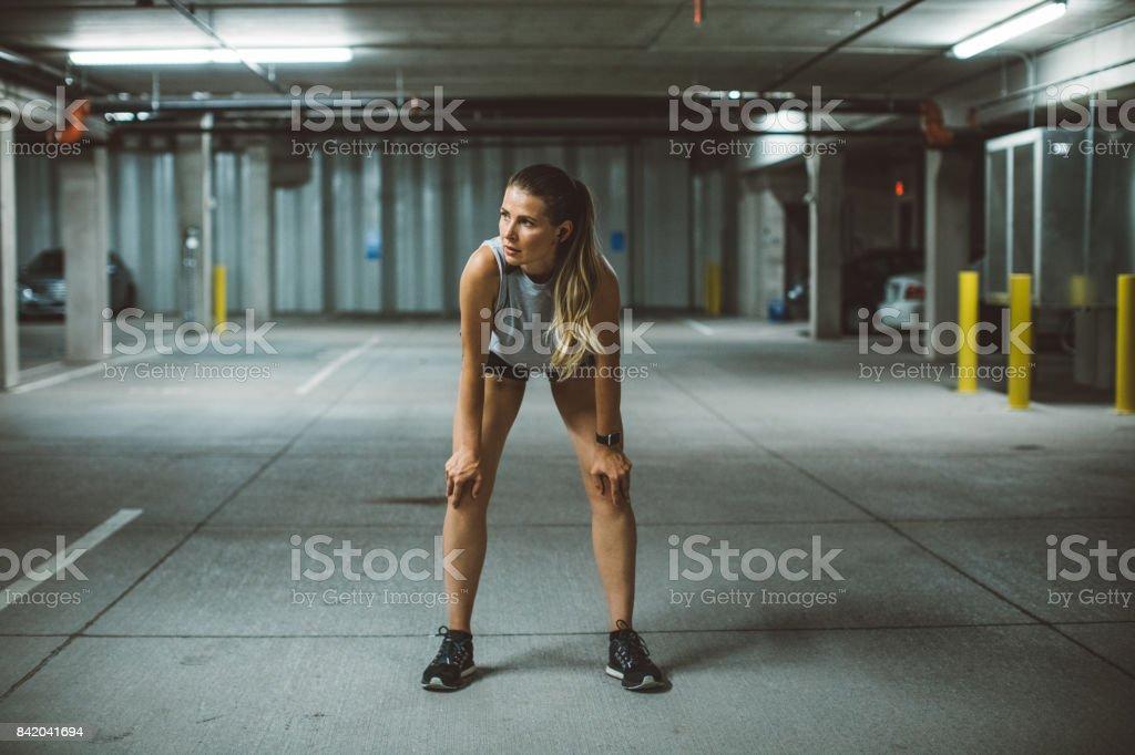 Woman exercising at city