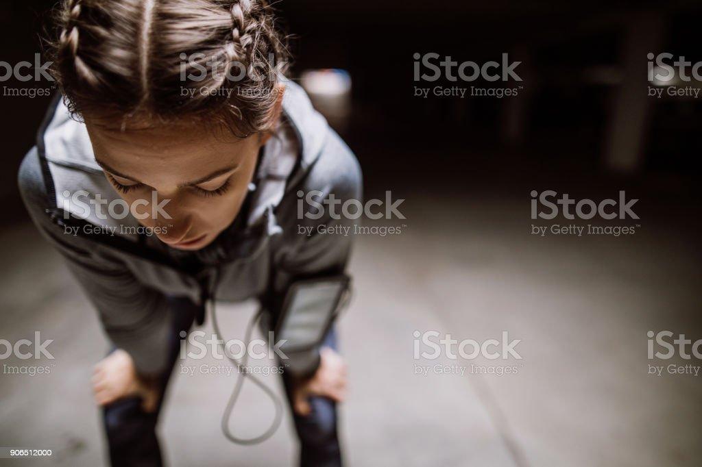 Young athlete jogging in underground garage
