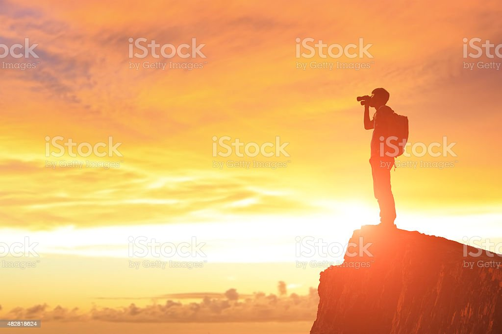 Success man on the mountain stock photo