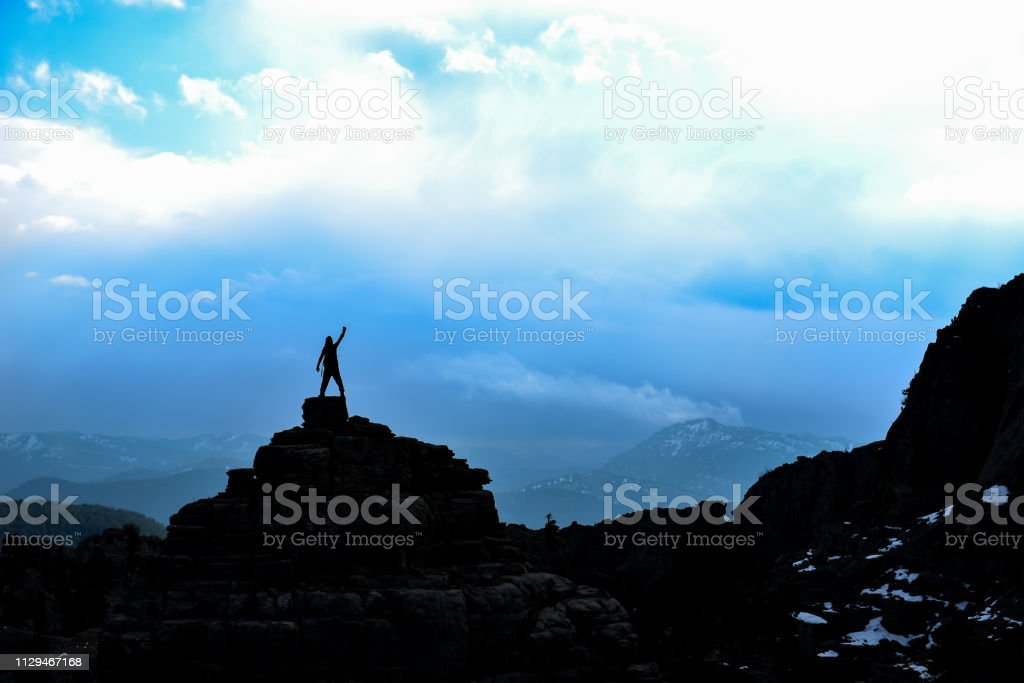 success of a proud climber reaching the goal stock photo