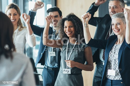Business People Celebrating with arm raised up