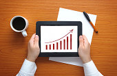 Businessman showing growth chart on tablet pc.Please see some similar pictures from my portfolio: