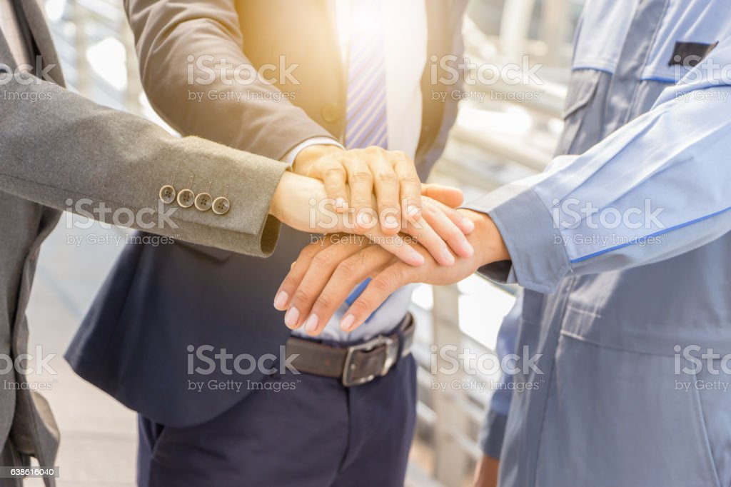 Success Teamwork concept, Business people joining hands city background. stock photo