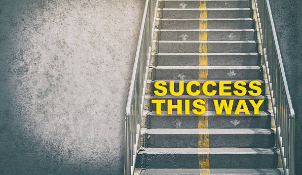 Success This Way Step up the success stair - foto de stock