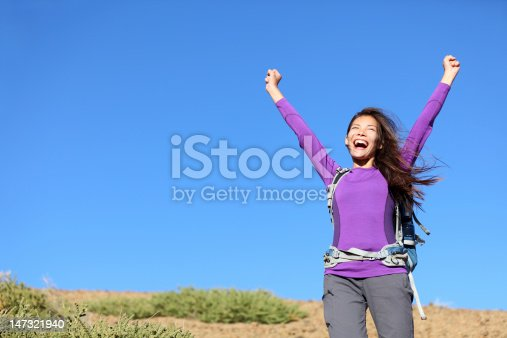 istock success woman happy outside 147321940