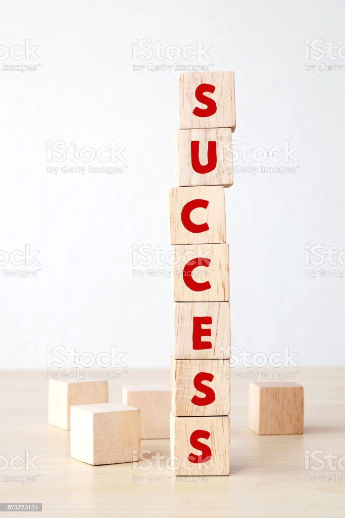 Success word on wooden cubes, success in business concept stock photo